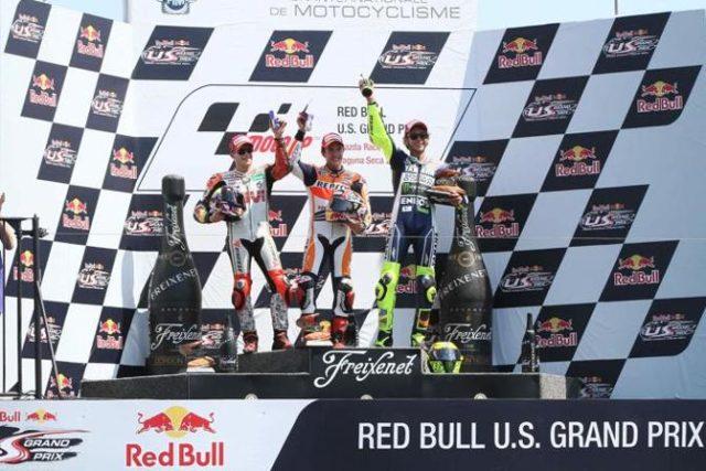 Il podio della MotoGP con Marquez tra Bradl e Rossi