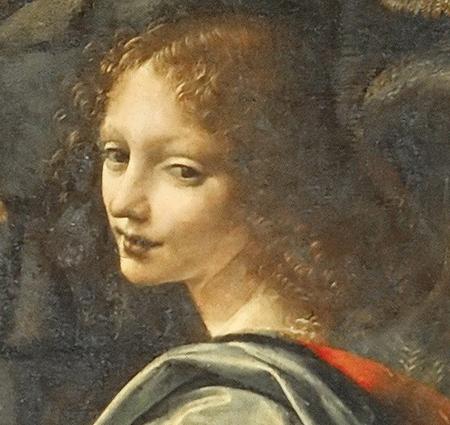 Dettaglio volto dell'angelo de La Vergine delle Rocce di Leonardo al Louvre